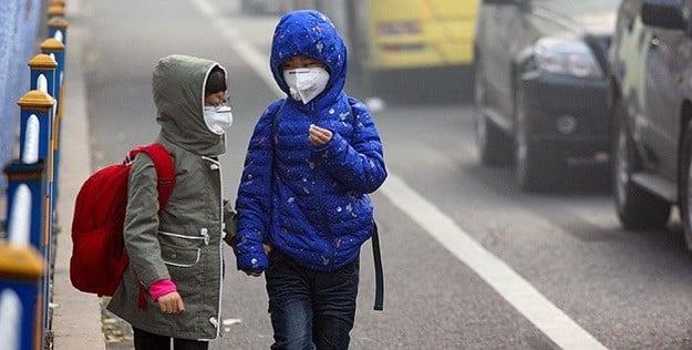 two children street smog cars city